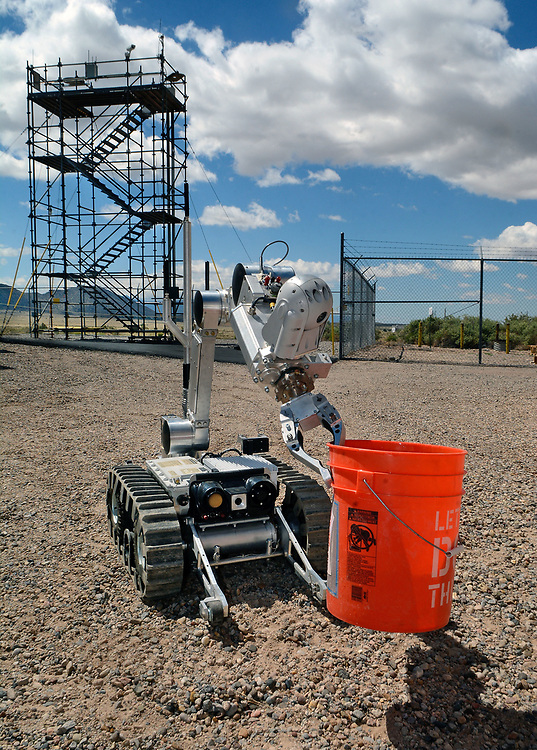 jt052317d/ a sec/jim thompson/ The robot carries a bucket of radioactive water to a container in the senecio for the Western National Robot Redeo held at Sandia National Labs. Tuesday May. 23, 2017. (Jim Thompson/Albuquerque Journal)