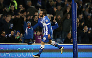 Inigo Calderon, Brighton defender scores a goal and celebrates during the Sky Bet Championship match between Brighton and Hove Albion and Leeds United at the American Express Community Stadium, Brighton and Hove, England on 24 February 2015.