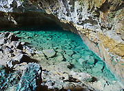 Mineral hot springs emerge in a cave at Orakei Korako Cave and Thermal Park, New Zealand, North Island