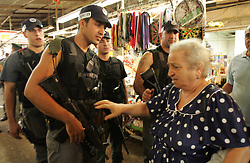 Israeli security forces are seen trying to help upset bystanders at the scene of a suicide bomb attack in Tel Aviv, Israel, Nov. 1, 2004. Three people were killed and dozens were wounded when Palestinian Aamer Alfar, 16, blew himself up in a crowded open-air food market in the heart of Israel's commercial capital. He was from the Askar refugee camp near the northern West Bank city of Nablus.