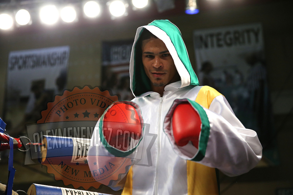 "Julio Santos poses prior to a ""Boxeo Telemundo"" boxing match at the Kissimmee Civic Center on Friday, July 18, 2014 in Kissimmee, Florida.  (AP Photo/Alex Menendez)"