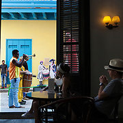 The classic Ambos Mundos Hotel, the bar is a must stop by visitors to Cuba, located in La Habana Vieja or Old Havana on the famous Calle Obispo.  The hotel was a former haunt of Ernest Hemingway.  Photography by Jose More