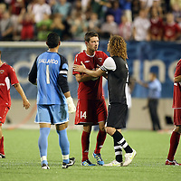 Orlando City Lions Midfielder Luke Boden (14) and Newcastle United Defender Sanchez Jose Enrique (3) shake hands after an International Friendly soccer match between English Premier League team Newcastle United and the Orlando City Lions of the United Soccer League, at the Florida Citrus Bowl on Saturday, July 23, 2011 in Orlando, Florida. Orlando won the match 1-0. (AP Photo/Alex Menendez)