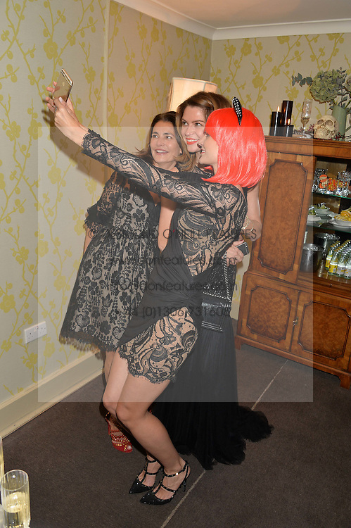 Left to right, AVERYL OATES, GABRIELLA PEACOCK and KIM JOHNSON at the Bumpkin Halloween Dinner hosted by Marissa Hermer held at Bumpkin, 119 Sydney Street, London on 23rd October 2014.