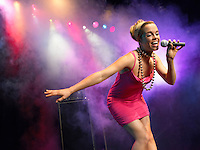 Young Woman Singing on stage in Concert low angle view