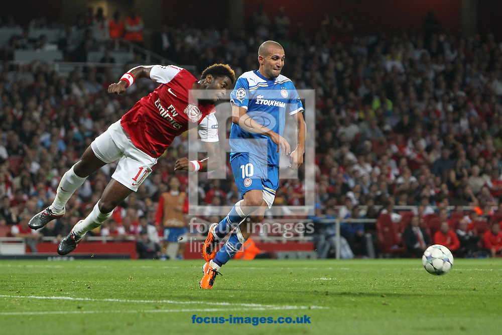 Picture by Paul Chesterton/Focus Images Ltd. 07904 640267.28/9/11.Alex Song of Arsenal heads clear during the UEFA Champions League Group F match at The Emirates Stadium, London.