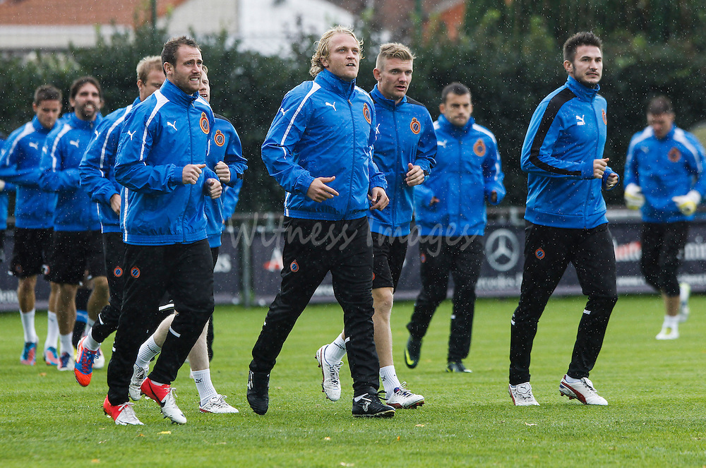 (L-R) Club Brugge Players Bart Buysse, Bjorn Vleminckx, Michael Almeback and Carl Hoefkens take part in a training session at Jan Breydel Stadium in Brugge, Belgium, 3 October 2012. Club Brugge will face Maritimo in the UEFA Europa League Group D soccer match on October 4.