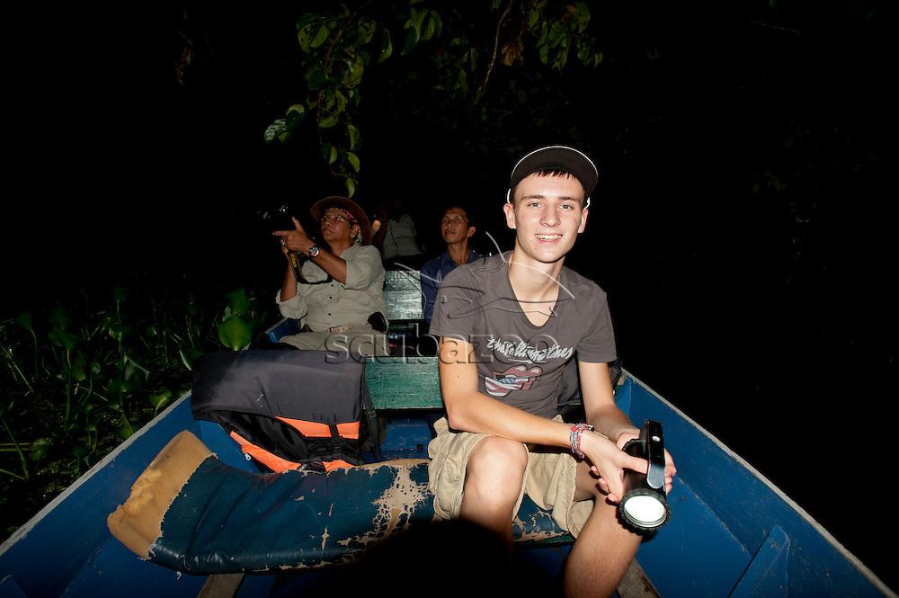 Tourists on a night safari along the Kinabatangan River, Kinabatangan, Sabah, Malaysia, Borneo