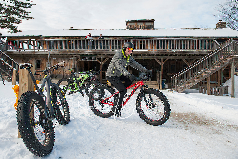 """Jeff Syms gears up to catch up with his daughter Marcella Tonge during Saturday's 50th """"then and now"""" anniversary at Highlands Mountain Bike Park.  (Karen Bobotas/for the Laconia Daily Sun)"""
