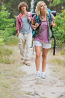 Full length of hiking couple in forest