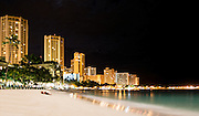 Waikiki Beach before dawn with a young couple enjoying the solitude.
