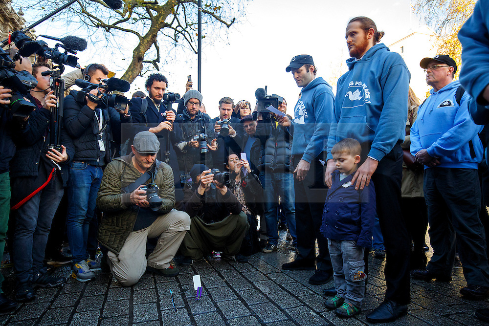 © Licensed to London News Pictures. 08/12/2015. London, UK. A group of veterans of Gulf War, Iraq, Afghanistan and Libya throw down their medals outside Downing Street in a protest against the attack on Syria. The protest is organised by Veterans For Peace on Tuesday, 8 December 2015. Photo credit: Tolga Akmen/LNP