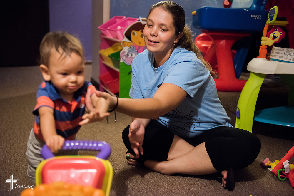 Resident and expectant mother Tiffany Busse helps her son Ezekiel Vela learn to walk during evening playtime at A Place of Refuge on Tuesday, Sept. 1, 2015, in Milwaukee, Wis. LCMS Communications/Erik M. Lunsford