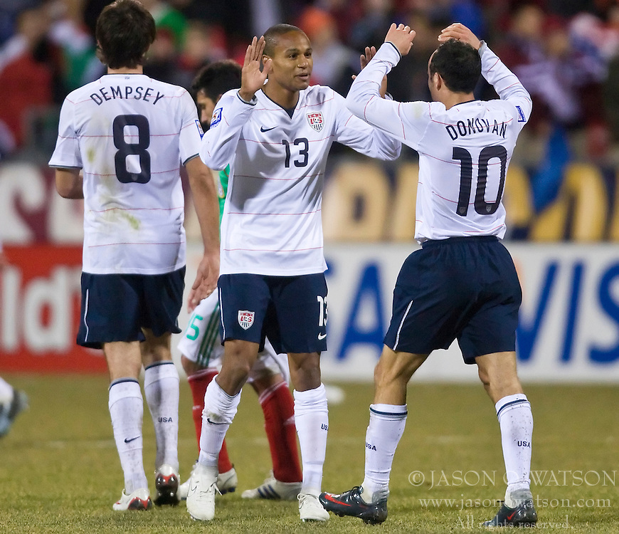 United States midfielder Landon Donovan (10) celebrates with United States midfielder Ricardo Clark (13) after a USA goal.  The United States men's soccer team defeated the Mexican national team 2-0 in CONCACAF final group qualifying for the 2010 World Cup at Columbus Crew Stadium in Columbus, Ohio on February 11, 2009.