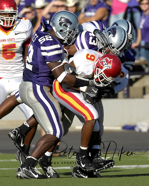 Kansas State defenders Zach Diles (52) and Antwon Moore (43) tackle Iowa State wide reciever Euseph Messiah (9) in the second half at Bill Snyder Family Stadium in Manhattan, Kansas, October 28, 2006.  The Wildcats beat the Cyclones 31-10.<br />