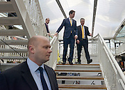 © Licensed to London News Pictures. 01/03/2013. Eastleigh, UK Liberal Democrat leader and Deputy Prime Minister Nick Clegg (centre left) meets with Mike Thornton MP (right) flanked by personal police officers the morning after his by-election victory . Campaigning in the weeks ahead of The Liberal Democrats winning the Eastleigh by-election, with the UK Independence Party pushing the Conservatives into third place.. Photo credit : Stephen Simpson/LNP