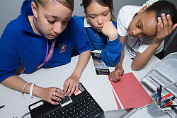 Group of students looking up information on  the internet during music lesson,