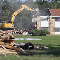 Crews from Century Construction continue to tear down the apartments at Presidents Gate on Lawndale Street in Tupelo Thursday morning.
