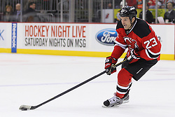 Jan 4, 2012; Newark, NJ, USA; New Jersey Devils right wing David Clarkson (23) skates with the puck during the second period at the Prudential Center.