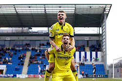 COLCHESTER, ENGLAND - Saturday, February 23, 2013: Tranmere Rovers' Ash Taylor celebrates scoring the third goal against Colchester United with team-mate Max Power during the Football League One match at the Colchester Community Stadium. (Pic by Vegard Grott/Propaganda)