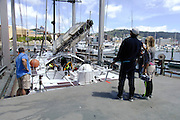 Michèle Paret and Dominique Wavre look on as Temenos 2 is hauled out of the water in Wellington. Barcelona World Race. 2/1/2008
