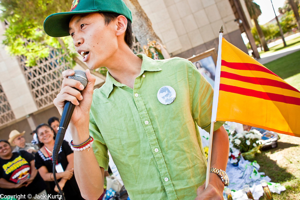 """June 13 - PHOENIX, AZ: BAO NGUYEN, from Garden Grove, CA, and an immigrant from Vietnam, speaks at an immigrants' rally and vigil in Phoenix Sunday. About 40 immigrants' rights activists from Anaheim, California, joined Phoenix area activists at the Arizona State Capitol Sunday for a prayer vigil and rally against SB 1070, the Arizona law that gives local law enforcement agencies the power to ask to see proof of immigration status in the course of a """"lawful contact"""" and when """"practicable."""" Immigrants' rights and civil rights activist say the bill will lead to racial profile. Proponents of the bill say it is the toughest local anti-immigration bill in the country and merely brings state law into line with federal immigration law.  The law, which was signed by the Arizona Governor in April, goes into effect on July 29, 2010.   Photo by Jack Kurtz"""