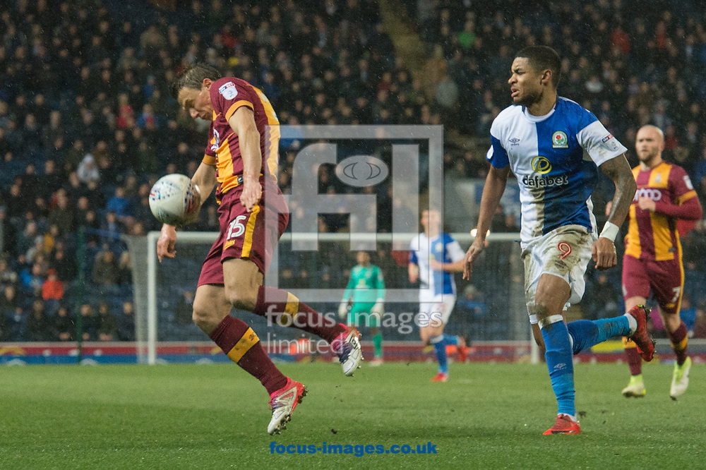 Stephen Warnock of Bradford City attempts to control the ball ahead of Dominic Samuel of Blackburn Rovers during the Sky Bet League 1 match at Ewood Park, Blackburn<br /> Picture by Matt Wilkinson/Focus Images Ltd 07814 960751<br /> 29/03/2018