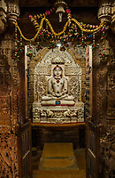 Beautifully carved image of Rishabdev in a Jain temple within Jaisalmer Fort, India.