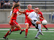 1 MAY 2010 -- O'FALLON, MO. -- Francis Howell North High School girls' soccer player Breann Kinworthy (10, CQ) controls the ball in front of a pair of Ursuline defenders during the championship game of the 19th Annual St. Dominic / Howell North Shootout Saturday, May 1, 2010 at St. Dominic High School in O'Fallon, Mo. Ursuline beat Howell North 2-1. Photo © copyright 2010 by Sid Hastings.