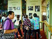 13 DECEMBER 2017 - BANGKOK, THAILAND:  People walk through the pavilion dedicated to the life of the late Bhumibol Adulyadej, the King of Thailand, at the Royal Crematorium on Sanam Luang in Bangkok. The crematorium was used for the funeral of His Majesty. He was cremated on 26 October 2017. The crematorium is open to visitors until 31 December 2017. It will be torn down early in 2018. More than 3 million people have visited the crematorium since it opened to the public after the cremation of the King.    PHOTO BY JACK KURTZ