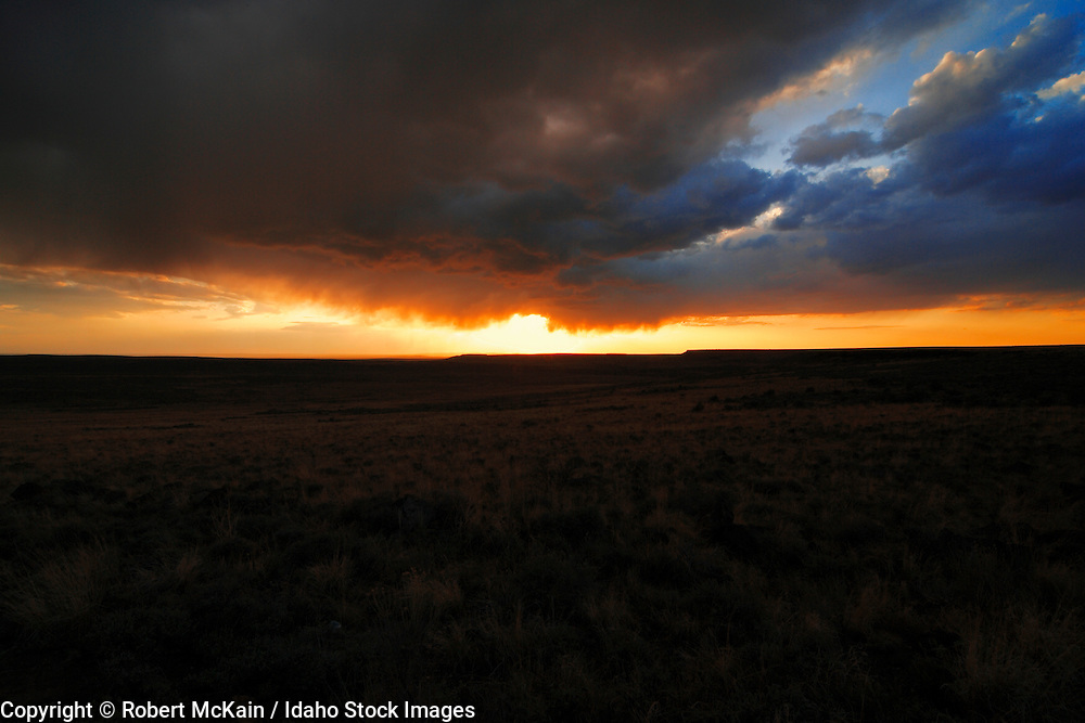 IDAHO. Highway 51 near Riddle. Sunset and storm clouds. May 2006. #lu060121