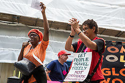 London, UK. 29 July, 2019. Activists from Reclaim the Power, All African Women's Group, Docs Not Cops, Lesbians and Gays Support the Migrants and other groups take part in a demonstration outside the Home Office to demand an end to the Government's 'hostile environment' policies.