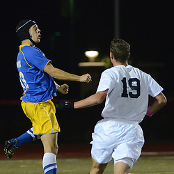 Photos by Tom Kelly IV<br /> West's Wade Knaster (18) goes up for a header as Rustin's Dane Andersson (19) look on during the Downingtown West vs West Chester Rustin boys District One semifinal soccer game which was held Wednesday night October 30, 2013 at West Chester East High School.