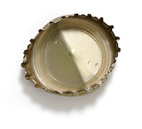 Bent bottle cap on white background