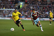 Andre Gray of Burnley and Emilio Nsue of Middlesbrough battle for the ballduring the Sky Bet Championship match between Burnley and Middlesbrough at Turf Moor, Burnley, England on 19 April 2016. Photo by Simon Brady.