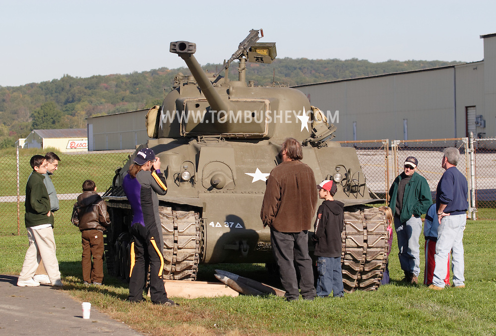 Montgomery, N.Y. - People look at a Sherman tank on display at Orange County Airport on Sept. 29, 2006.