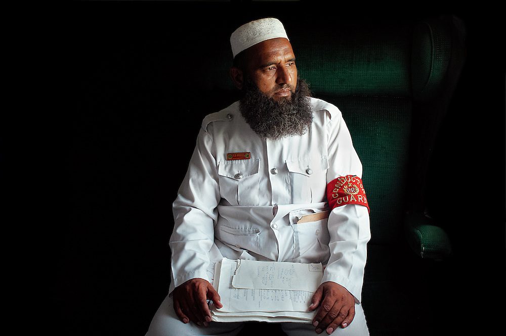 "Train Conductor Muhammad Baghah Mughal, 43 years old sits on the Khyber Mail traveling from Rawalpindi to Karachi on August 13, 2011. He was born in Lahore in 1967 and has worked for Pakistan Rail for 22 years. He has three children; one son and two daughters. ""Pakistan is a beautiful country, it's problem is the government and it's president. The politicians are not good for Pakistan. I want a simple life, enough money to eat, relax and pray."""