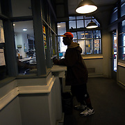 WASHINGTON, DC-OCT14: Michael Evans, 54, talks to the manager at Capital Self-Storage, October 14, 2015, in Washington, DC. Evans who has slept on the streets for years, stores his belongings at the facility, and spends much of his day around his unit. Many of the area homeless have possessions they want to keep safe, just nowhere permanent to live, so they store their belongings at Capital Self-Storage, where an upper-level unit costs $30/month. Some of the homeless patrons also spend their days in their storage units, when shelters are closed during midday hours. The storage facility near 3rd and Florida Avenue in Northeast, Washington, DC, is about to be replaced by a boutique hotel. (Photo by Evelyn Hockstein/For The Washington Post)
