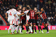 Steve Cook (3) of AFC Bournemouth and James Tomkins (5) of Crystal Palace square up to each other as tensions rise during the Premier League match between Bournemouth and Crystal Palace at the Vitality Stadium, Bournemouth, England on 1 October 2018.