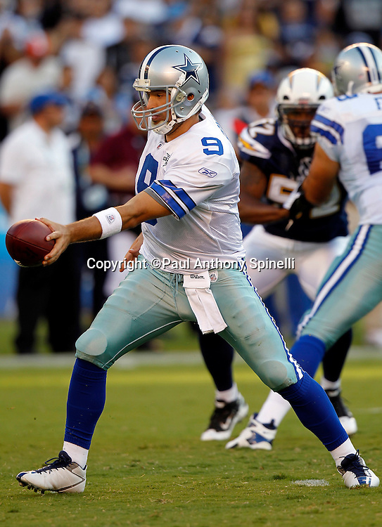 Dallas Cowboys quarterback Tony Romo (9) hands off the ball on a running play during the NFL week 2 preseason football game against the San Diego Chargers on Saturday, August 21, 2010 in San Diego, California. The Cowboys won the game 16-14. (©Paul Anthony Spinelli)