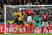 Manchester United Midfielder Nemanja Matic heads clear from Wolverhampton Wanderers midfielder Romain Saiss (27) during the The FA Cup match between Wolverhampton Wanderers and Manchester United at Molineux, Wolverhampton, England on 16 March 2019.