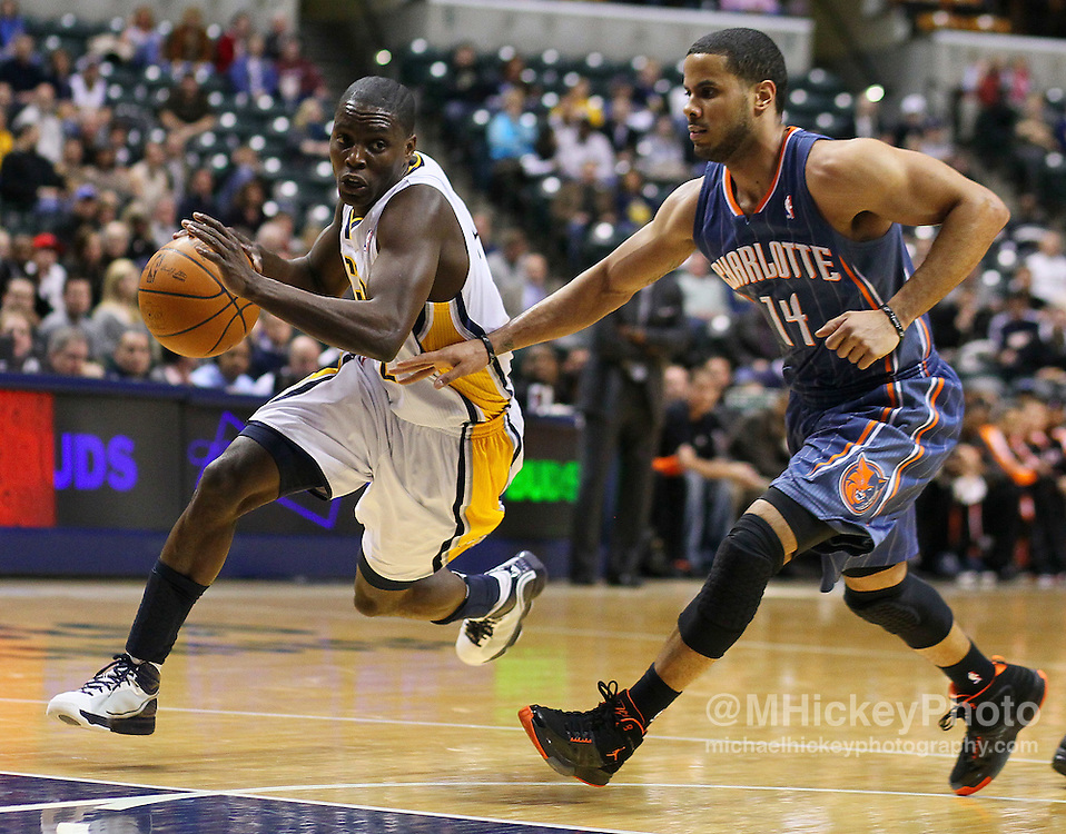 Feb. 09, 2011; Indianapolis, IN, USA; Indiana Pacers guard Darren Collison (2)  dribbles to the basket against Charlotte Bobcats point guard D.J. Augustin (14) at Conseco Fieldhouse. Indiana defeated Charlotte 104-103. Mandatory credit: Michael Hickey-US PRESSWIRE
