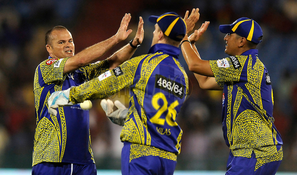 Charl Langeveldt of Cape Cobras celebrates a wicket during match 3 of the Oppo Champions League Twenty20 between the Cape Cobras and the Northern Knights held at the Chhattisgarh International Cricket Stadium, Raipur, India on the 19th September 2014<br /> <br /> Photo by:  Pal Pillai / Sportzpics/ CLT20<br /> <br /> <br /> Image use is subject to the terms and conditions as laid out by the BCCI/ CLT20.  The terms and conditions can be downloaded here:<br /> <br /> http://sportzpics.photoshelter.com/gallery/CLT20-Image-Terms-and-Conditions-2014/G0000IfNJn535VPU/C0000QhhKadWcjYs