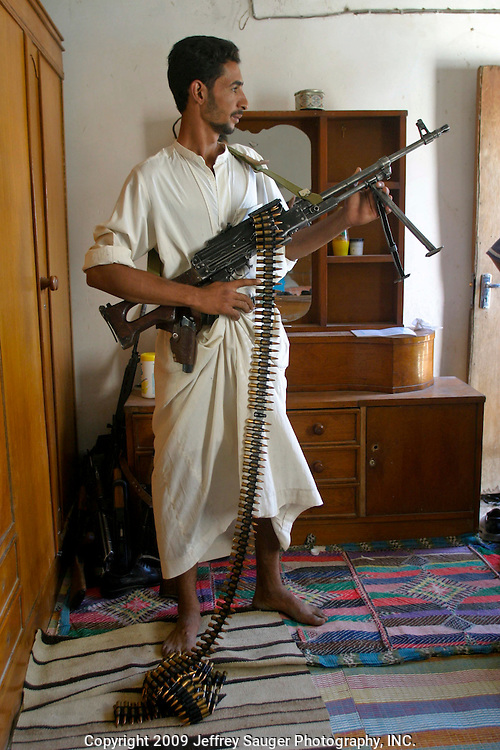 Ali Al-kasid shows off his Russian-made BKC machine gun during the Istikbal, or homecoming celebration, held in honor of his uncle Malik Al-Kasid's family Wednesday, July 30, 2003. The celebration lasts three days with tribal chiefs, family and friends coming and going each day. ..The Al-Kasid family fled Iraq after the Gulf War and their part in the uprising against Saddam Hussein in 1991, spent 3 years in Rafa, Saudi Arabia and finally settled in Dearborn, MI. The family hasn't been home to Iraq in 13 years. After their participation in the 1991 uprising, Saddam Hussein's forces burned the Al-Kasid family Motheff, along with their cars, to the ground.
