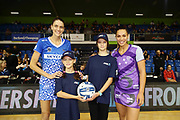 ANZ Future Captains Kate Hammond aged 8 and Ella Hammond aged 11 pose for a photo with Anna Harrison of the Mystics and Grace Kara of the Stars prior to the match. 2018 ANZ Premiership netball match, Mystics v Stars at The Trusts Arena, Auckland, New Zealand. 13 May 2018 © Copyright Photo: Anthony Au-Yeung / www.photosport.nz