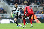 Matt Ritchie (#11) of Newcastle United takes on Terence Kongolo (#5) of Huddersfield Town during the Premier League match between Newcastle United and Huddersfield Town at St. James's Park, Newcastle, England on 31 March 2018. Picture by Craig Doyle.