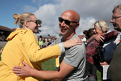 UK ENGLAND 30JUL17 - Hikers celebrate as they arrive at the finish line at Brighton racecourse after completing the Trailwalker 2017 challenge in the South Downs, England.<br /> <br /> jre/Photo by Jiri Rezac<br /> <br /> © Jiri Rezac 2017