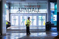 © Licensed to London News Pictures. 18/10/2019. Manchester, UK. Armed police and paramedics respond and the Arndale Centre in Manchester City Centre in evacuated after reports of a man armed with a knife in the shopping centre . Photo credit: Joel Goodman/LNP