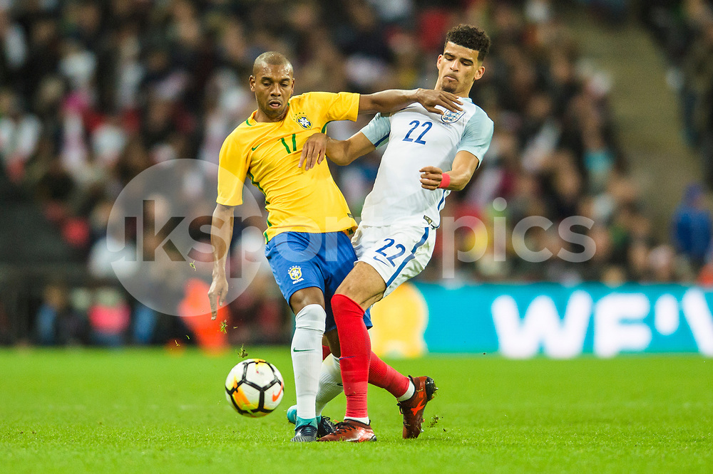 Dominic Solanke of England gets in a challenge on Fernandinho of Brazil during the international friendly match between England and Brazil at Wembley Stadium, London, England on 14 November 2017. Photo by Darren Musgrove.