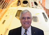 Garden City, New York, U.S. June 6, 2019. Apollo 17 astronaut HARRISON SCHMITT poses in front of the genuine Rockwell Command  Module 002, Command and Service Module with splashdown parachute attached, during Cradle of Aviation Museum's Apollo Astronauts Press Conference during its day of events celebrating 50th Anniversary of Apollo 11. CSM-002 was used for  A-004, the final test of Apollo launch escape vehicle and first flight of a Block 1 Apollo Command Service Module.